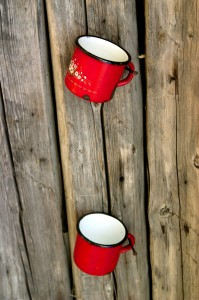 Metal red mugs on the wood wall